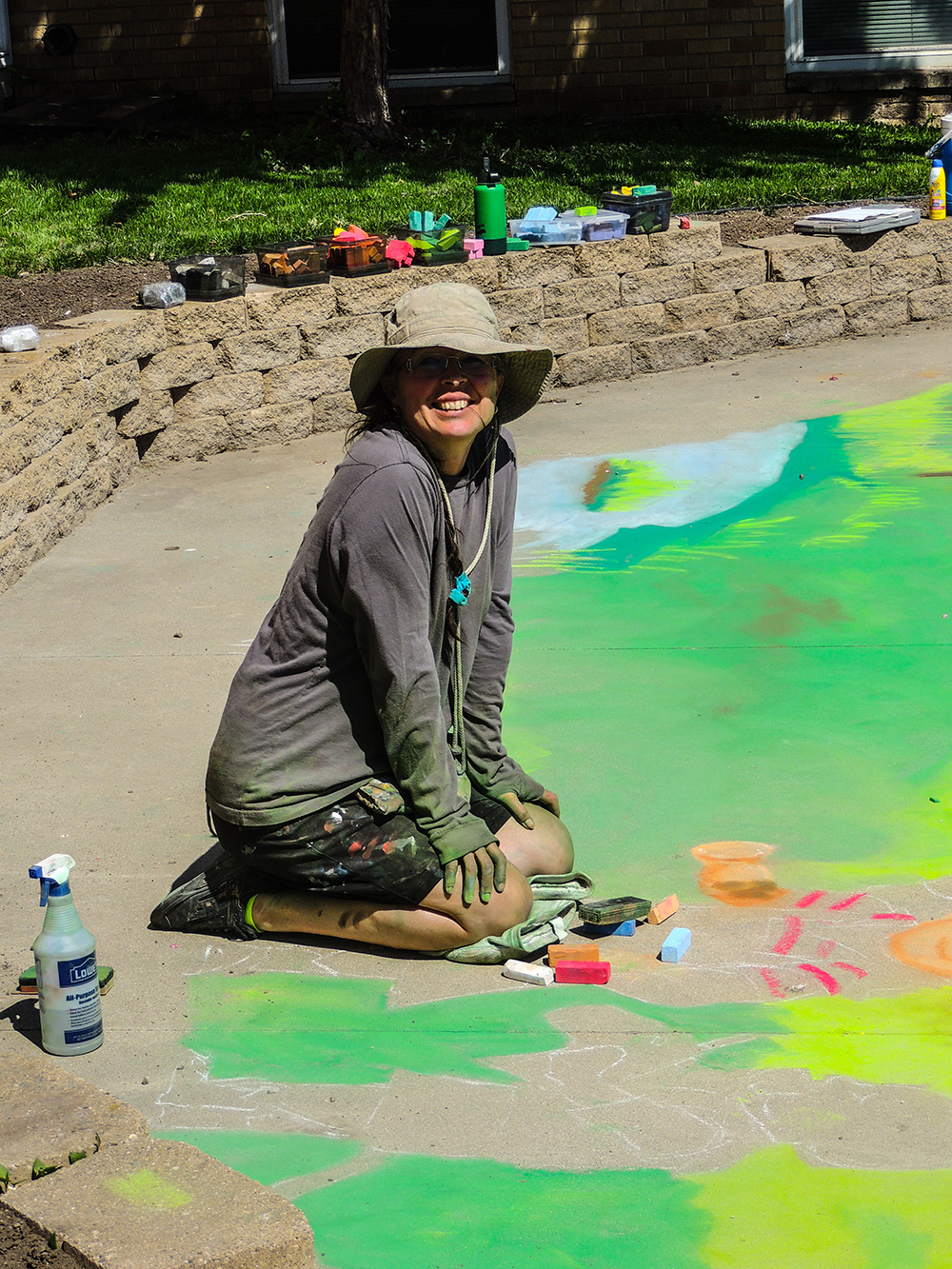 Photo of Melissa Gordon kneeling by chalk drawing