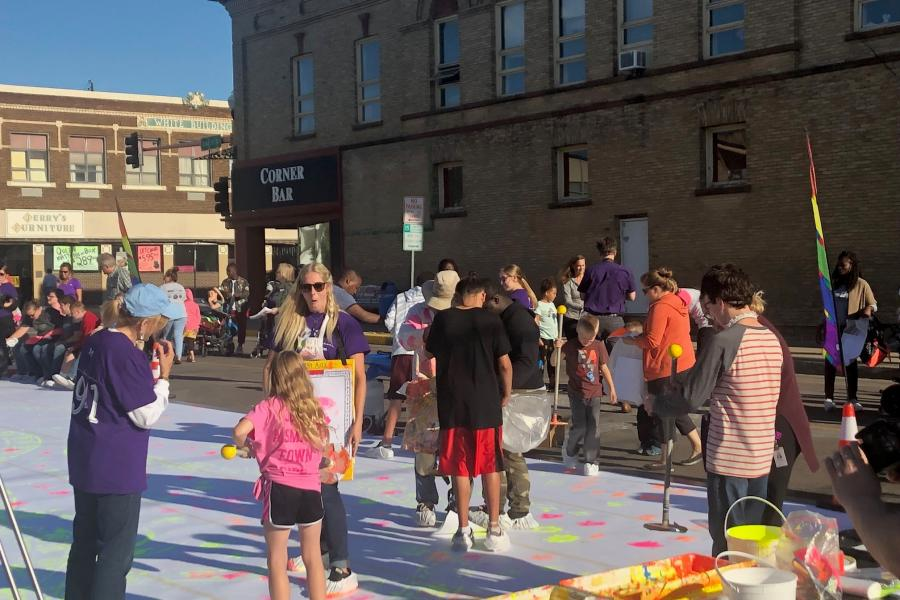 Photo of Zot Artz program and people participating in art activities outside in Jamestown