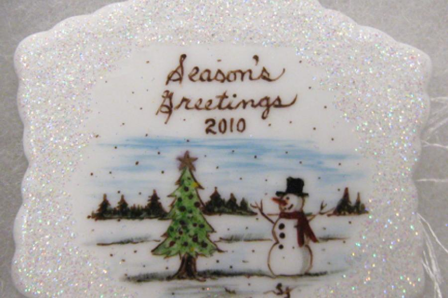 Season Greetings ornaments with tree and snowman