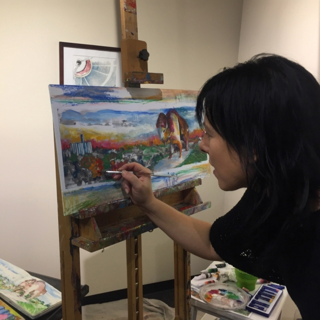 Photo of Linda Roesch painting