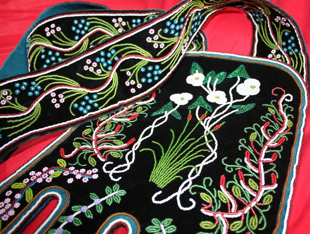 A photo of floral beadwork on black velvet by Ojibway master Marvin Baldeagle Youngman,  St. John, ND.
